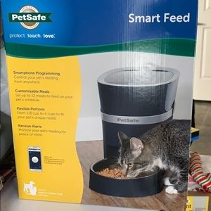 Smartphone dog feeder. Never opened
